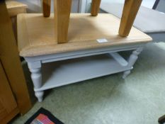 A grey painted coffee table with shelf (54.