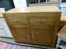 An oak sideboard with two drawers over two doors (66.
