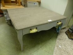 A decorative blue painted coffee table with drawer (68.