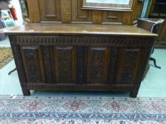 A reproduction oak coffer,