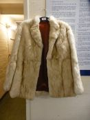 A ladies cream fur jacket