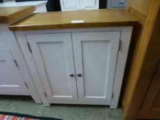 An ivory painted two door cupboard (82.