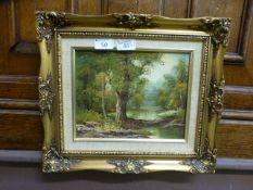 A gilt framed oil of river flowing through wooded scene