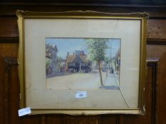 A framed and glazed watercolour of Henley In Arden signed G.A.