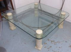 LOW TABLE, rounded edge glass top raised on spiral twist column's with metal work support,