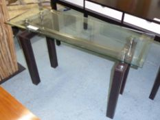CONSOLE TABLE, with bevelled glass top, on square leather clad supports, 122cm x 44cm x 76cm H.
