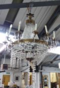 WITHDRAWN CHANDELIER, of substantial proportions, twelve branch, gilt metal with glass droplets,
