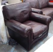 PARKER KNOLL ARMCHAIR, in tanned leather on block supports, 93cm W.