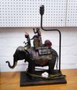 BRONZE TABLE LAMP OF ELEPHANT WITH MONKEY IN HOODAH, 49cm H, 40cm W x 50cm H.