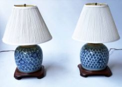 LAMPS, two, Chinese ceramic blue and white ginger jar form with wooden bases, 52cm H.