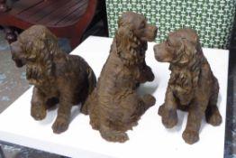 COCKER SPANIELS, a set of three, stylised ceramics, 42cm h.