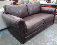 PARKER KNOLL SOFA, two seater in tanned leather on block supports, 175cm L.