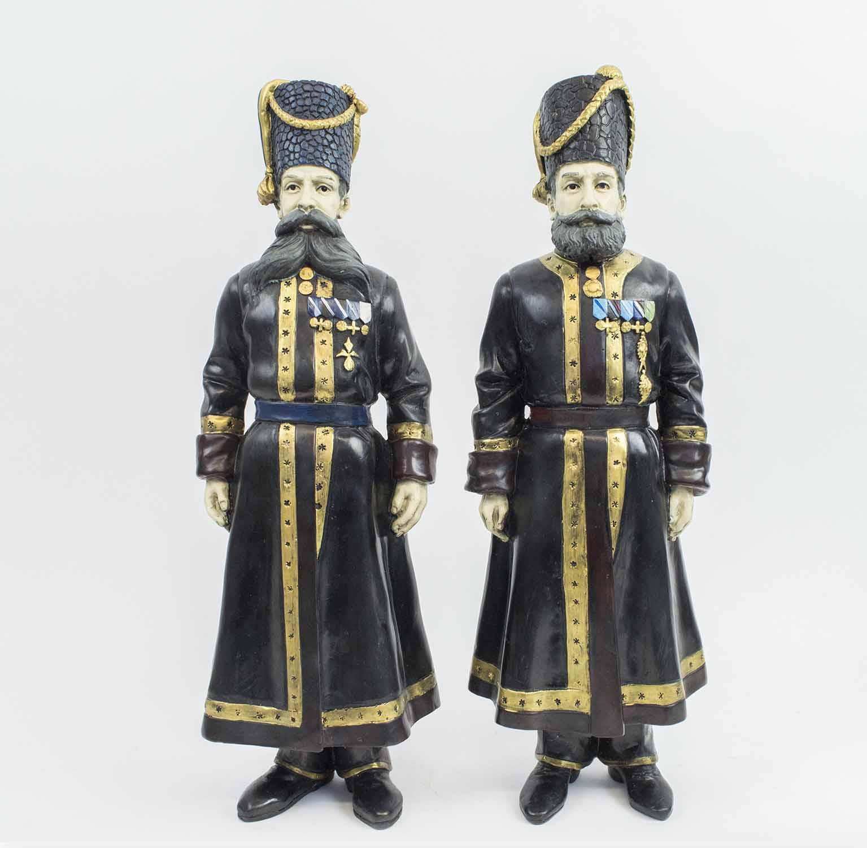 Lot 457 - FABERGE MANNER BRONZE COSSACKS, a pair, Pustynnikov chamber Cossack 1894,