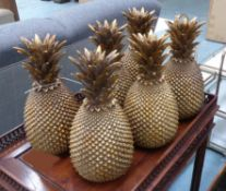 FAUX PINEAPPLES, a set of six, gilt finish, 31cm H.