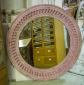 WALL MIRROR, Indian pink painted with circular carved pendant frame, 120cm D.