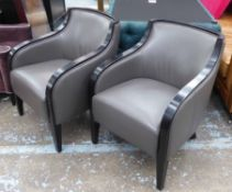 CONTEMPORARY ARMCHAIRS, grey leather with ebonised showframes, each 65cm W x 83cm H.
