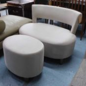 SMALL SOFA, contemporary style, 102cm x 75cm H with a matching oval footstool, 47cm H x 56cm.