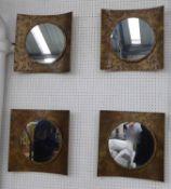 WALL MIRRORS, a set of four, contemporary design, bronzed frames, 40cm H.
