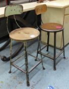VINTAGE WORK STOOLS, two, of differing design, 95cm at highest.
