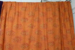 CURTAINS, a pair, Designers Guild orange and gold patterned, lined and interlined,