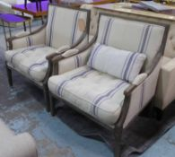 BERGERE ARMCHAIRS, a pair, French Provincial design, in a striped linen fabric, with showframes,