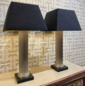 ATTRIBUTED TO ANDREW MARTIN COLUMN LAMPS, a pair, with shades, 90cm H.