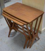 NEST OF THREE TABLES, circa 1960, teak with bowed rectangular tops, largest 53cm H x 56cm W x 36cm