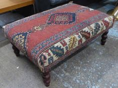 FOOTSTOOL, English country house style, upholstered in a vintage carpet, on turned supports, 63cm