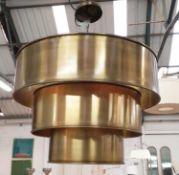 CHANDELIER, three tiered gilt metal design, 210cm drop.