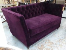 SOFA, with a buttoned back, inner sides and purple upholstery on short turned supports, 154cm L x