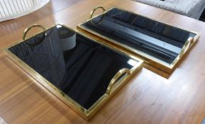 TRAYS, a pair, gilt metal and smoked glass, 50cm x 30cm x 8cm. (2)