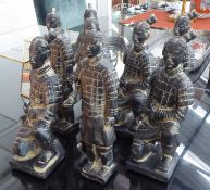 TABLE TOP FAUX TERRACOTTA CHINESE WARRIORS, a set of eight, various poses, largest 35cm. (8)