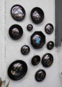 CONVEX WALL MIRRORS, a set of twelve, Regency style, various sizes and shapes, ebonised finish, 26cm