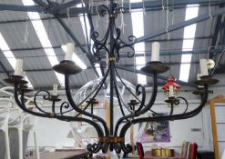 CHANDELIER, ten branch, contemporary worked metal, black painted with gilt accents, 195cm drop x