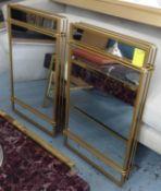 WALL MIRRORS, a pair, gilt metal frames, 81cm x 51cm (2).