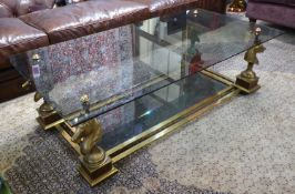 MAISON CHARLES STYLE LOW TABLE, brass and burr walnut with two tinted glass tiers on horse head