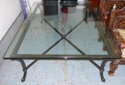 LOW TABLE, the glass top on a metal base, 110cm D x 45cm H x 150cm L.