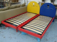 CHILDREN'S BEDS, a pair, polychrome painted finish with design cut into headboards, 195cm x 88cm x
