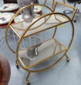 COCKTAIL TROLLEY, gilt metal and glass.