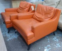 LIGNE ROSET ARMCHAIRS, a pair, orange leather upholstered, 80cm x 93cm x 72cm H. (2)