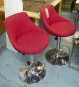 BAR STOOLS, a set of three, contemporary, height adjustable, red fabric upholstered, 107cm at