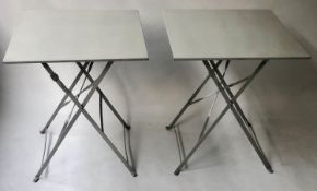 BISTRO TABLES, a pair, French grey painted, square with folding x supports, 60cm x 60cm x 72cm. (2)