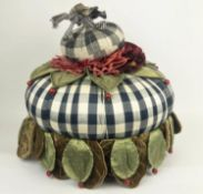 FOOTSTOOL, by Victoria and Richard MacKenzie-Childs, upholstered in an assortment of fabrics, 45cm