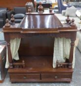 TEMPLE DOG BED, mahogany with carved front pillars, 96cm W x 44cm D x 115cm H.