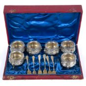 A 19TH CENTURY RED LEATHER BOX containing six white metal salts with matching shovels, all