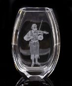 A HADELAND NORWEGIAN GLASS VASE with an engraved violin player decoration, 17.5cm wide x 25cm high