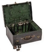A LATE 19TH / EARLY 20TH CENTURY LEATHER TRAVELLING CASE with four silver and tortoise shell