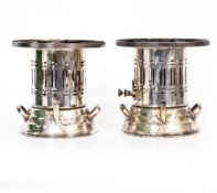 A PAIR OF SILVER PLATED FOOD WARMERS with pierced decoration, each 23cm high x 24.5cm diameter