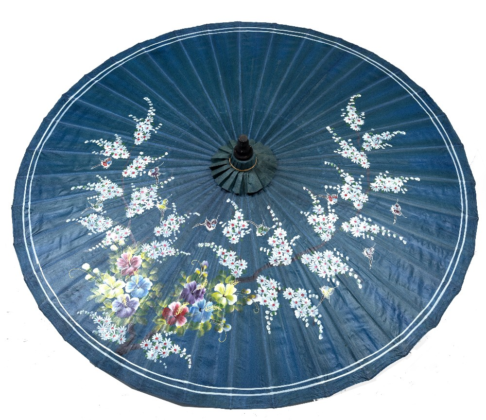 Lot 1181 - A JAPANESE BLUE GROUND PARASOL painted with white blossom on a branch, approximately 150cm diameter