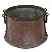 AN ANTIQUE COPPER VESSEL OR LOG BIN of cylindrical tapering form with iron handles, 45cm diameter